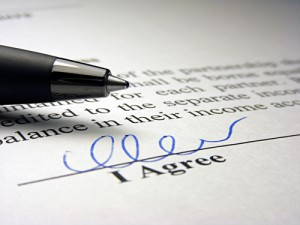 Signature line for an employment agreement.